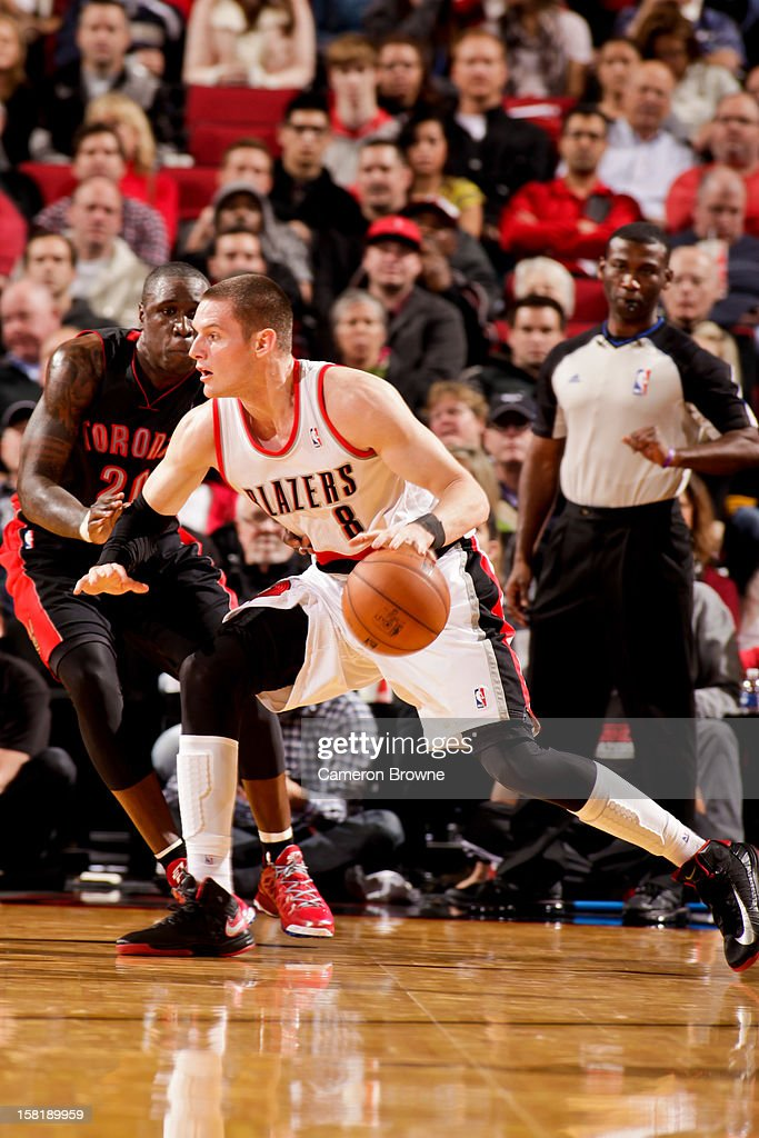 <a gi-track='captionPersonalityLinkClicked' href=/galleries/search?phrase=Luke+Babbitt&family=editorial&specificpeople=5122155 ng-click='$event.stopPropagation()'>Luke Babbitt</a> #8 of the Portland Trail Blazers drives against <a gi-track='captionPersonalityLinkClicked' href=/galleries/search?phrase=Mickael+Pietrus&family=editorial&specificpeople=202910 ng-click='$event.stopPropagation()'>Mickael Pietrus</a> #20 of the Toronto Raptors on December 10, 2012 at the Rose Garden Arena in Portland, Oregon.