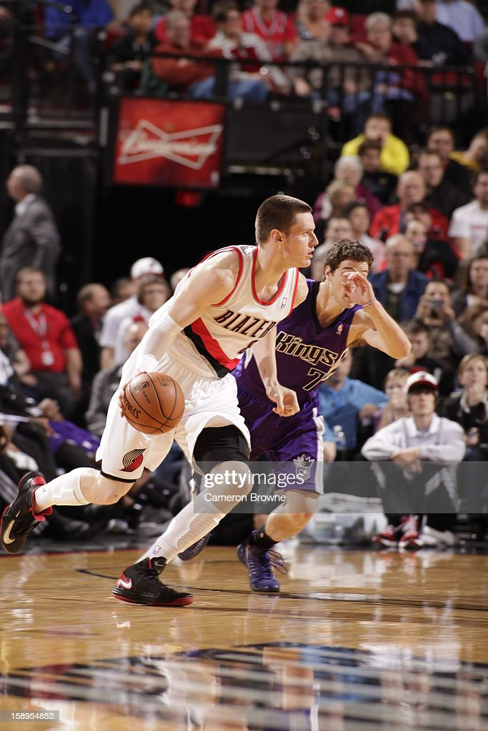 <a gi-track='captionPersonalityLinkClicked' href=/galleries/search?phrase=Luke+Babbitt&family=editorial&specificpeople=5122155 ng-click='$event.stopPropagation()'>Luke Babbitt</a> #8 of the Portland Trail Blazers drives to the basket against the Sacramento Kings on December 26, 2012 at the Rose Garden Arena in Portland, Oregon.