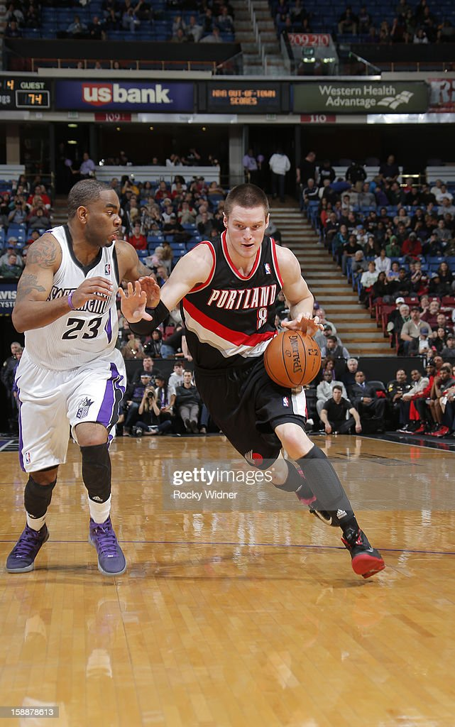 <a gi-track='captionPersonalityLinkClicked' href=/galleries/search?phrase=Luke+Babbitt&family=editorial&specificpeople=5122155 ng-click='$event.stopPropagation()'>Luke Babbitt</a> #8 of the Portland Trail Blazers drives to the hoop against <a gi-track='captionPersonalityLinkClicked' href=/galleries/search?phrase=Marcus+Thornton+-+Basketball+Player+Born+1987&family=editorial&specificpeople=4679329 ng-click='$event.stopPropagation()'>Marcus Thornton</a> #23 of the Sacramento Kings on December 23, 2012 at Sleep Train Arena in Sacramento, California.