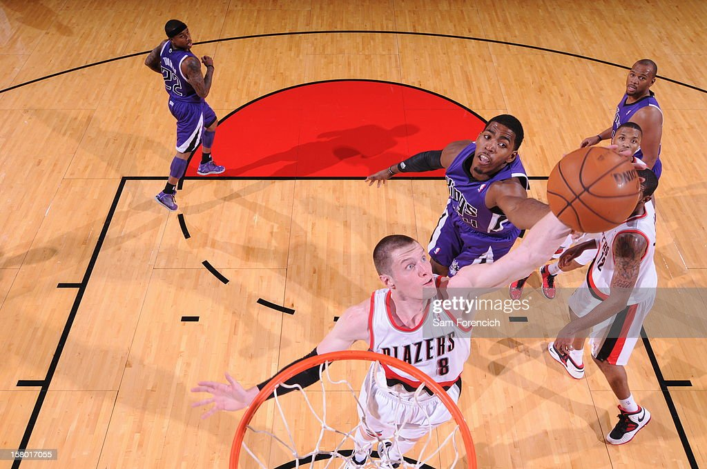 Luke Babbitt #8 of the Portland Trail Blazers goes to the basket against Jason Thompson #34 of the Sacramento Kings during the game between the Sacramento Kings and the Portland Trail Blazers on December 8, 2012 at the Rose Garden Arena in Portland, Oregon.