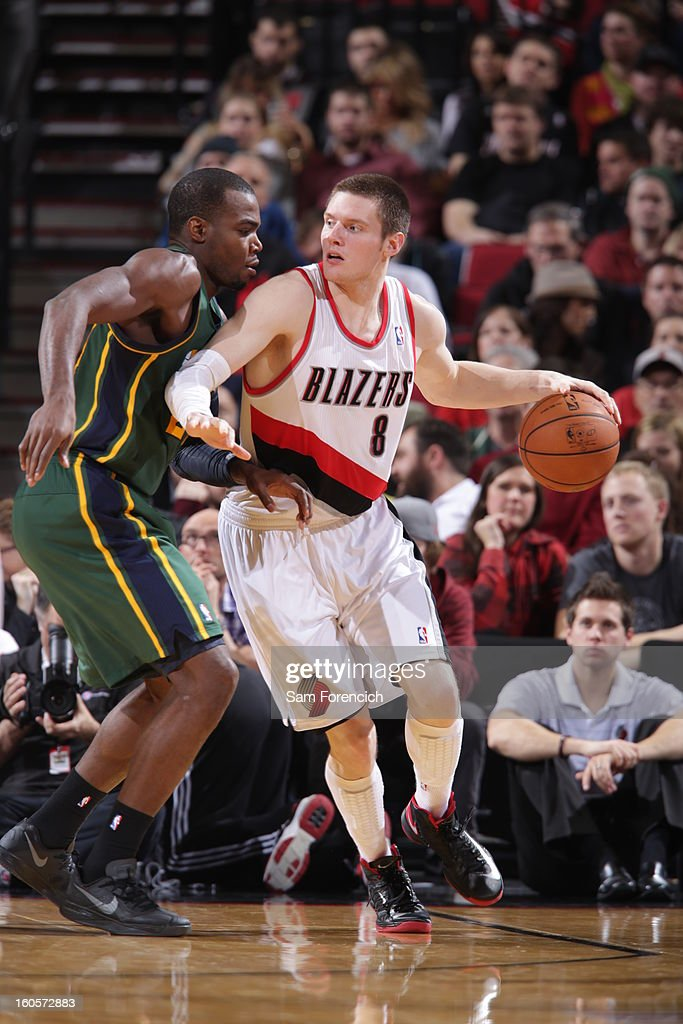 Luke Babbitt #8 of the Portland Trail Blazers protects the ball during the game between the Utah Jazz and the Portland Trail Blazers on February 2, 2013 at the Rose Garden Arena in Portland, Oregon.