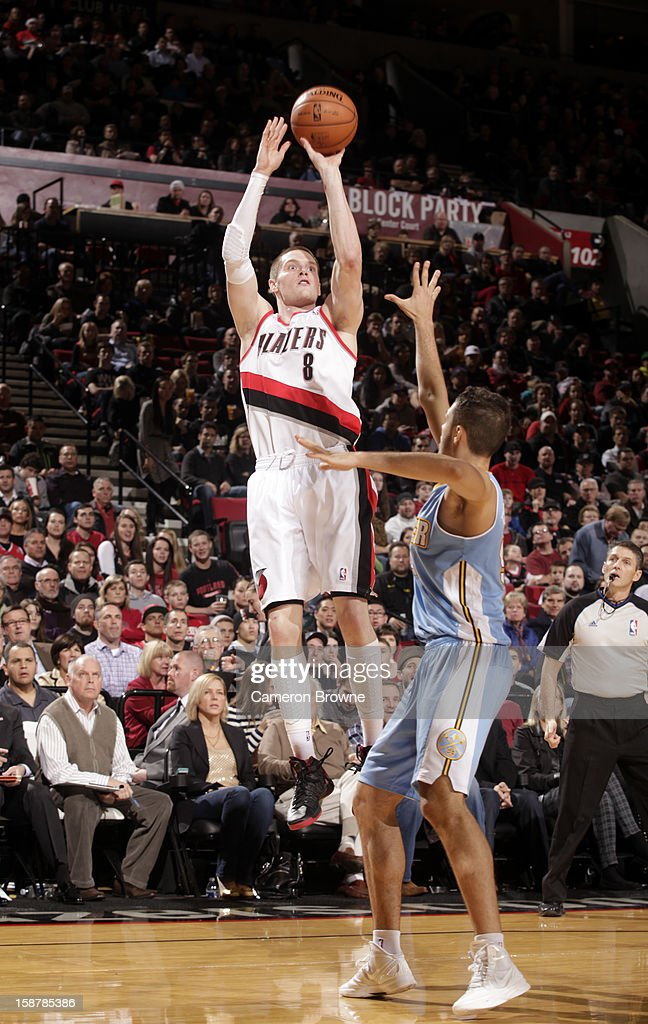 <a gi-track='captionPersonalityLinkClicked' href=/galleries/search?phrase=Luke+Babbitt&family=editorial&specificpeople=5122155 ng-click='$event.stopPropagation()'>Luke Babbitt</a> #8 of the Portland Trail Blazers takes a shot against the Denver Nuggets on December 20, 2012 at the Rose Garden Arena in Portland, Oregon.
