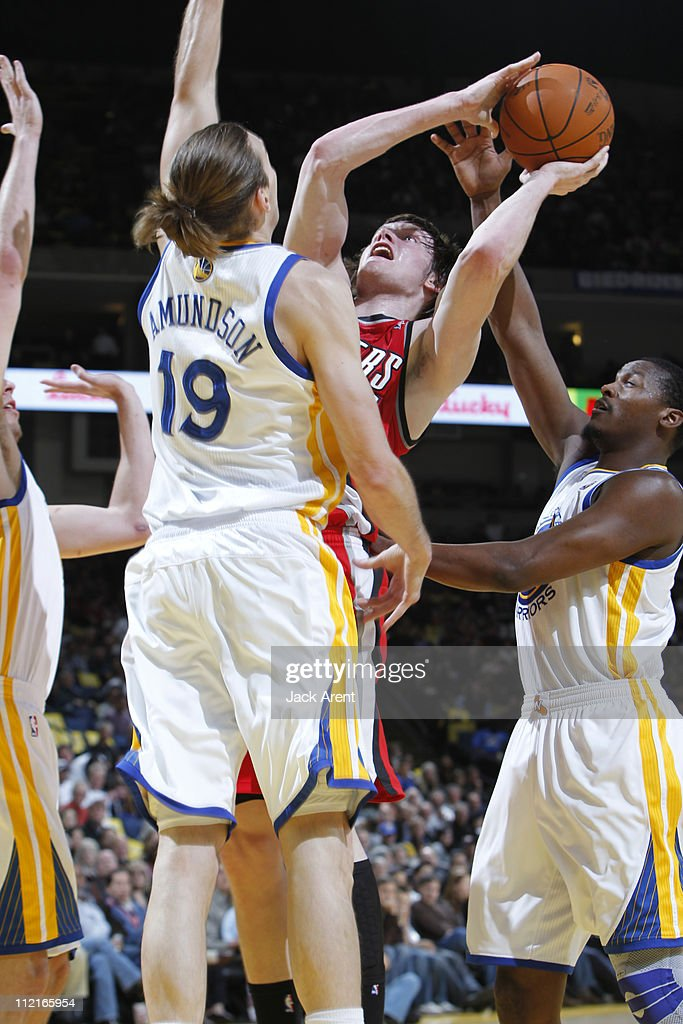<a gi-track='captionPersonalityLinkClicked' href=/galleries/search?phrase=Luke+Babbitt&family=editorial&specificpeople=5122155 ng-click='$event.stopPropagation()'>Luke Babbitt</a> #11 of the Portland Trail Blazers tries to score in traffic against the Golden State Warriors on April 13, 2011 at Oracle Arena in Oakland, California.