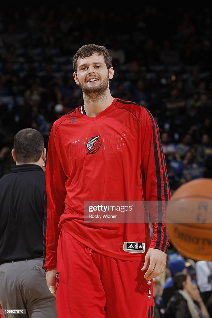 <a gi-track='captionPersonalityLinkClicked' href=/galleries/search?phrase=Luke+Babbitt&family=editorial&specificpeople=5122155 ng-click='$event.stopPropagation()'>Luke Babbitt</a> #8 of the Portland Trail Blazers warms up before a game against the Golden State Warriors on January 11, 2013 at Oracle Arena in Oakland, California.