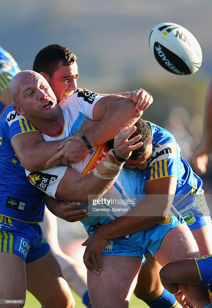 <a gi-track='captionPersonalityLinkClicked' href=/galleries/search?phrase=Luke+Bailey&family=editorial&specificpeople=198882 ng-click='$event.stopPropagation()'>Luke Bailey</a> of the Titan offloads the ball in a tackle during the round 11 NRL match between the Parramatta Eels and the Gold Coast Titans at Glen Willow Regional Sports Stadium on May 26, 2013 in Mudgee, Australia.