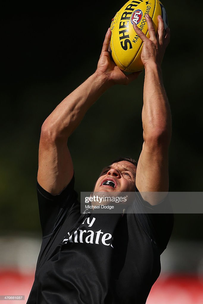<a gi-track='captionPersonalityLinkClicked' href=/galleries/search?phrase=Luke+Ball&family=editorial&specificpeople=208157 ng-click='$event.stopPropagation()'>Luke Ball</a> marks the ball during a Collingwood Magpies AFL training session at Olympic Park on February 20, 2014 in Melbourne, Australia.
