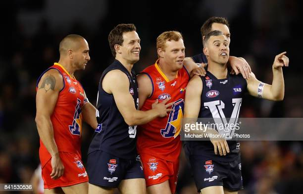 Luke Ball of Victoria Adam Cooney of the All Stars and Lindsay Gilbee of Victoria share a joke during the 2017 EJ Whitten Legends Game between...
