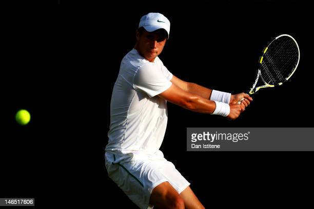 Luke Bambridge of Great Britain plays a backhand during the gentlemen's qualifying singles first round match against Roberto BautistaAgut of Spain on...