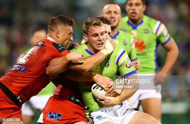 Luke Bateman of the Raiders is tackled during the round 19 NRL match between the Canberra Raiders and the St George Illawarra Dragons at GIO Stadium...