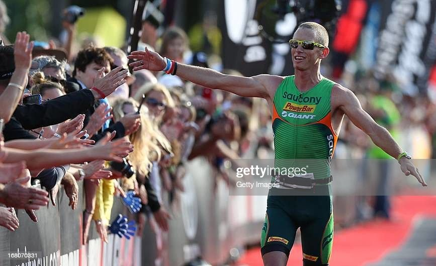 <a gi-track='captionPersonalityLinkClicked' href=/galleries/search?phrase=Luke+Bell+-+Triathlete&family=editorial&specificpeople=15201001 ng-click='$event.stopPropagation()'>Luke Bell</a> of Australia celebrates winning the Port Macquarie round of the 2013 Ironman Australia series on May 5, 2013 in Port Macquarie, Australia.