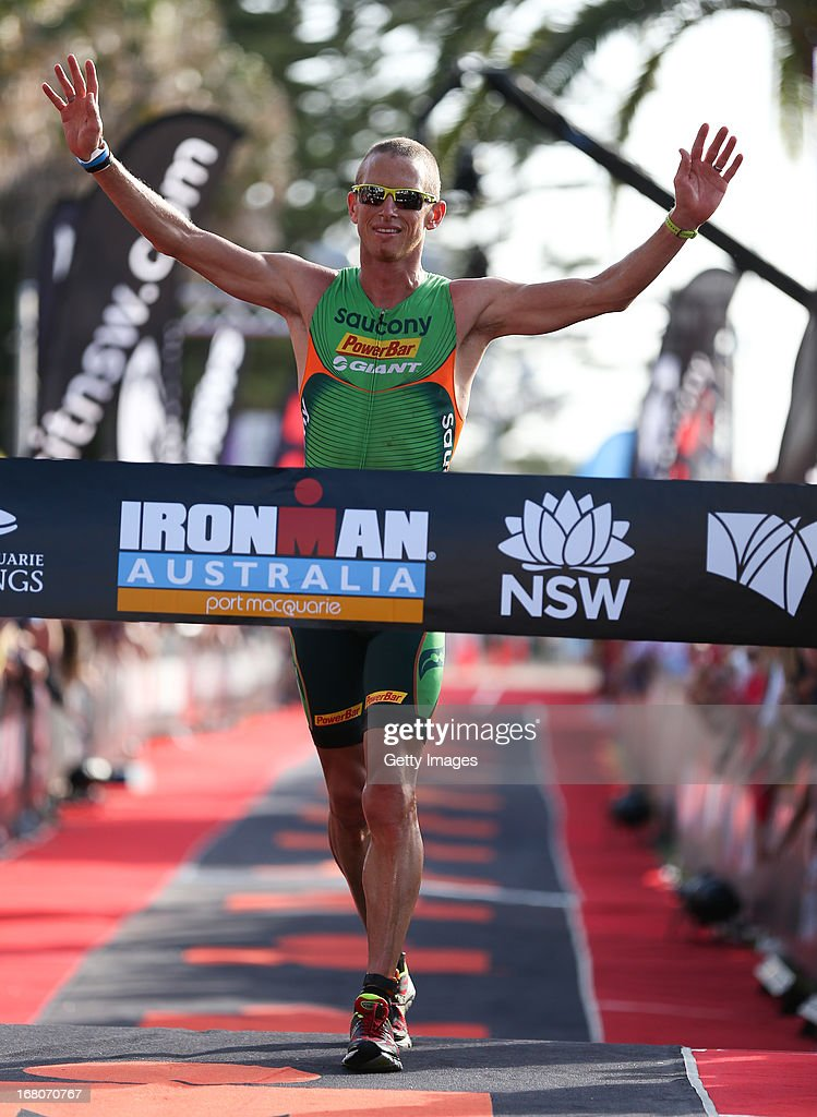 <a gi-track='captionPersonalityLinkClicked' href=/galleries/search?phrase=Luke+Bell+-+Triathlete&family=editorial&specificpeople=15201001 ng-click='$event.stopPropagation()'>Luke Bell</a> of Australia wins the Port Macquarie round of the 2013 Ironman Australia series on May 5, 2013 in Port Macquarie, Australia.