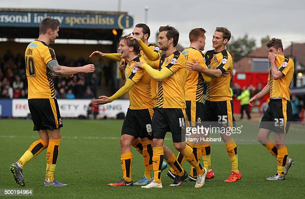 Luke Berry of Cambridge United celebrates with team mates during the Emirates FA Cup Second Round match between Cambridge United and Doncaster Rovers...