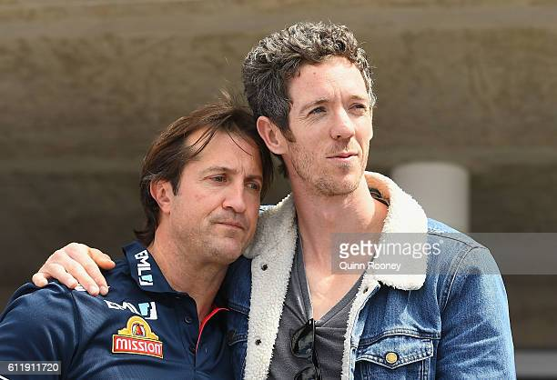 Luke Beveridge and Robert Murphy of the Bulldogs embrace during the Western Bulldogs AFL Grand Final celebrations at Whitten Oval on October 2 2016...