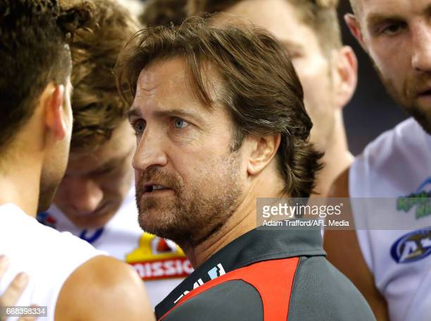 Luke Beveridge Senior Coach of the Bulldogs addresses his players during the 2017 AFL round 04 match between the North Melbourne Kangaroos and the...