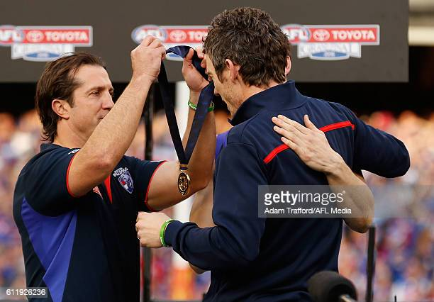 Luke Beveridge Senior Coach of the Bulldogs and Easton Wood Acting Captain of the Bulldogs present injured captain Robert Murphy with a premiership...