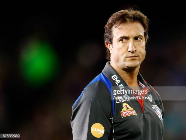 Luke Beveridge Senior Coach of the Bulldogs looks on during the 2017 AFL round 13 match between the Western Bulldogs and the Melbourne Demons at...