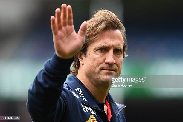 Luke Beveridge the head coach of the Bulldogs waves to the crowd during the 2016 AFL Grand Final match between the Sydney Swans and the Western...