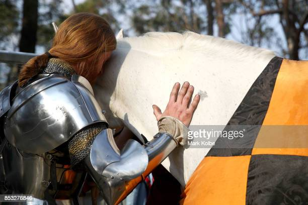 SYDNEY AUSTRALIA SEPTEMBER Luke Binks of Australia shares a moment with bis mount as he prepares to compete in the World Jousting Championships on...