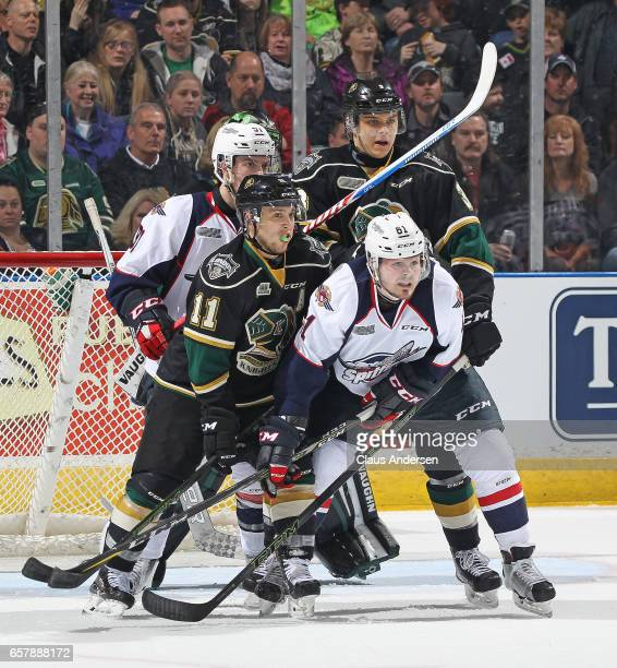 Luke Boka of the Windsor Spitfires battles against Owen MacDonald of the London Knights during Game One of the OHL Western Conference Quarter Finals...