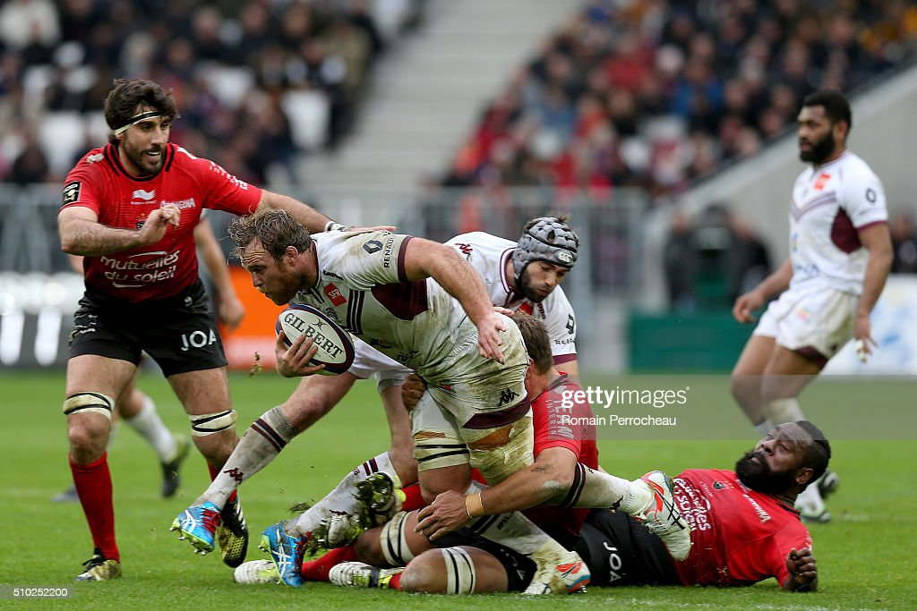 Luke Braid of Union Bordeaux Begles is tackled by Ratu Manasa Saulo Romumu of RC Toulon during the Top 14 rugby match between Union Bordeaux Begles and RC Toulon at Stade Matmut Atlantique on February 14, 2016 in Bordeaux, France.