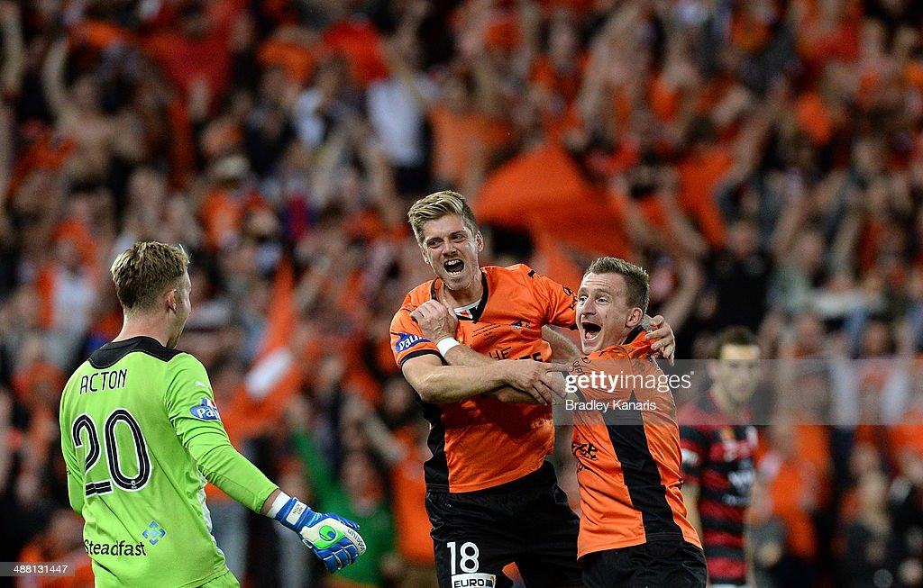 Luke Brattan and <a gi-track='captionPersonalityLinkClicked' href=/galleries/search?phrase=Besart+Berisha&family=editorial&specificpeople=737057 ng-click='$event.stopPropagation()'>Besart Berisha</a> of the Roar celebrate victory as the full time siren sounds after the 2014 A-League Grand Final match between the Brisbane Roar and the Western Sydney Wanderers at Suncorp Stadium on May 4, 2014 in Brisbane, Australia.