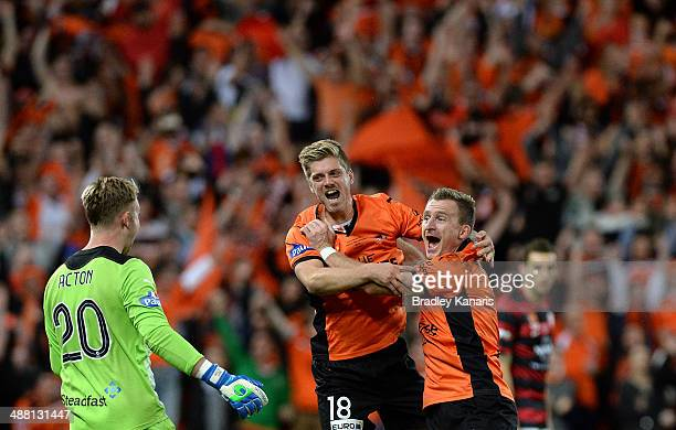 Luke Brattan and Besart Berisha of the Roar celebrate victory as the full time siren sounds after the 2014 ALeague Grand Final match between the...