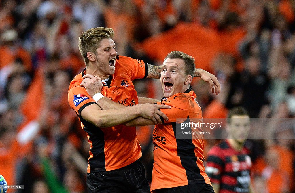 Luke Brattan and <a gi-track='captionPersonalityLinkClicked' href=/galleries/search?phrase=Besart+Berisha&family=editorial&specificpeople=737057 ng-click='$event.stopPropagation()'>Besart Berisha</a> of the Roar celebrate victory as the full time siren sounds the 2014 A-League Grand Final match between the Brisbane Roar and the Western Sydney Wanderers at Suncorp Stadium on May 4, 2014 in Brisbane, Australia.