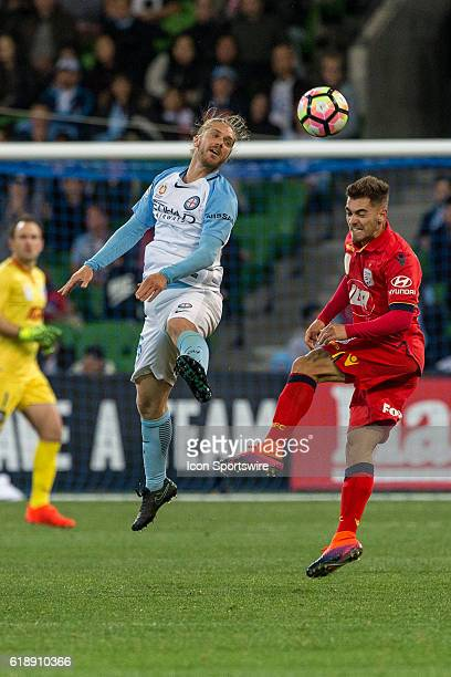 Luke Brattan of Melbourne City and Ben Garuccio of Adelaide United contest the ball during the 4th round of the Hyundai ALeague between Melbourne...