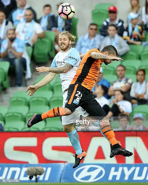 Luke Brattan of Melbourne City and Dimitri Petratos of the Roar compete for the ball during the round nine ALeague match between Melbourne City FC...
