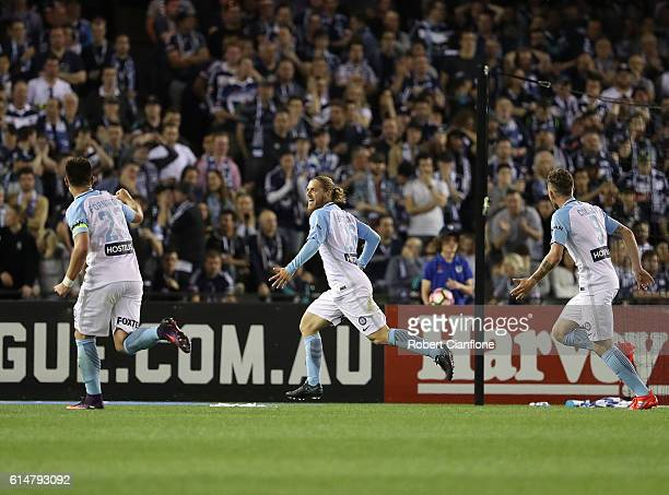 Luke Brattan of Melbourne City celebrates after scoring a goal during the round two ALeague match between Melbourne Victory and Melbourne City FC at...