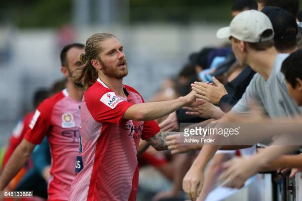 Luke Brattan of Melbourne City celebrates the win with fans during the round 22 ALeague match between the Central Coast Mariners and Melbourne City...
