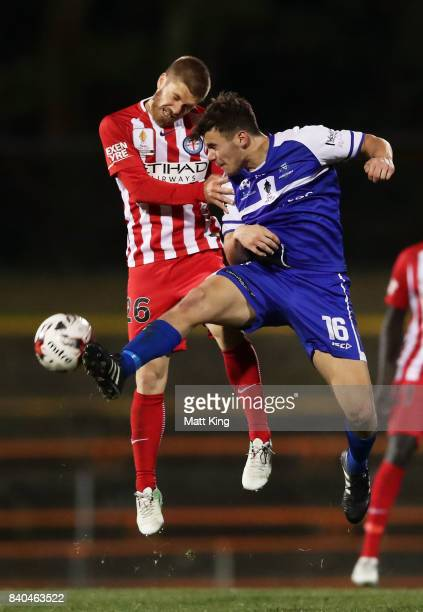 Luke Brattan of Melbourne City competes for the ball against Oliver Green of Hakoah during the FFA Cup round of 16 match between Hakoah Sydney City...