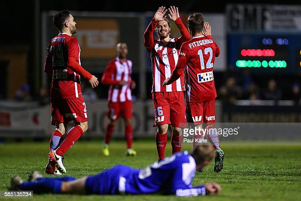 Luke Brattan of Melbourne City congratulates Nick Fitzgerald after scoring the opening goal during the FFA Cup Round of 32 match between Floreat...