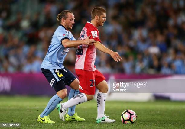 Luke Brattan of Melbourne City is challenged by Rhyan Grant of Sydney FC during the round 25 ALeague match between Sydney FC and Melbourne City FC at...