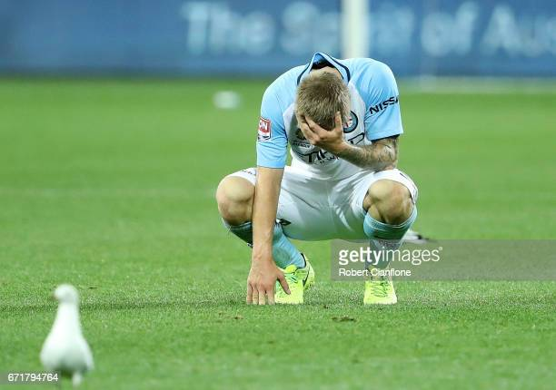 Luke Brattan of Melbourne City is dejected after the City were defeated by Oerth Glory during the ALeague Elimination Final match between Melbourne...