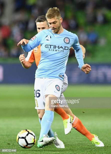 Luke Brattan of the City passes the ball during the round one ALeague match between Melbourne City FC and the Brisbane Roar at AAMI Park on October 6...