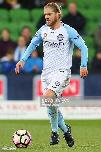Luke Brattan of the City runs with the ball during the round three ALeague match between Melbourne City FC and Perth Glory at AAMI Park on October 21...