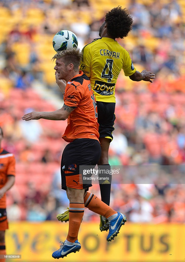 Luke Brattan of the Roar and Isaka Cernak of the Phoenix challenge for the ball during the round 21 A-League match between the Brisbane Roar and the Wellington Phoenix at Suncorp Stadium on February 17, 2013 in Brisbane, Australia.