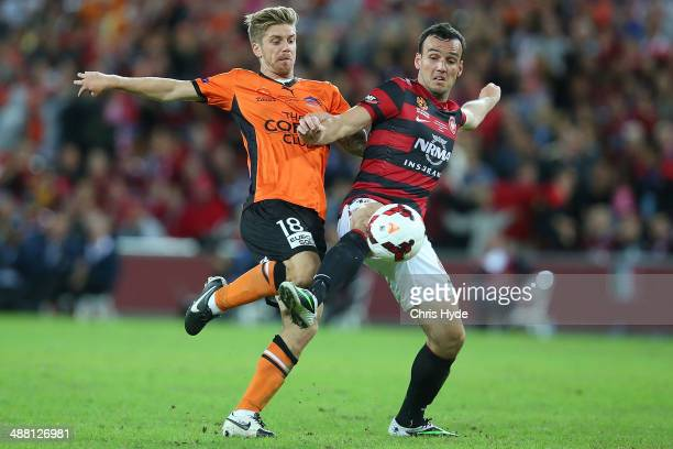Luke Brattan of the Roar and Mark Bridge of the Wanderers compete for the ball during the 2014 ALeague Grand Final match between the Brisbane Roar...
