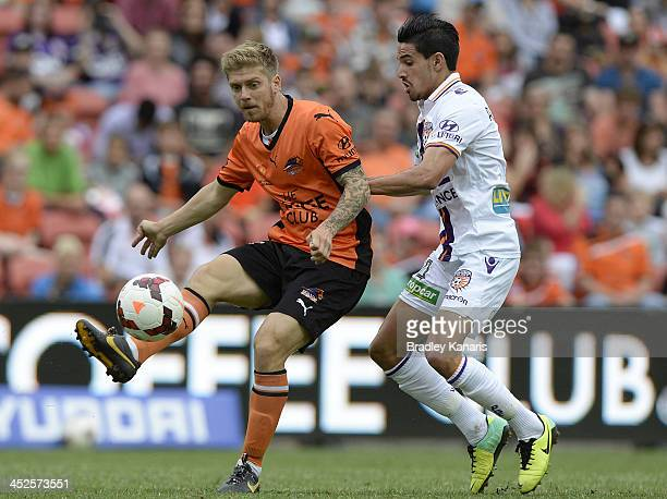 Luke Brattan of the Roar gets a pass away during the round eight ALeague match between Brisbane Roar and Perth Glory at Suncorp Stadium on November...
