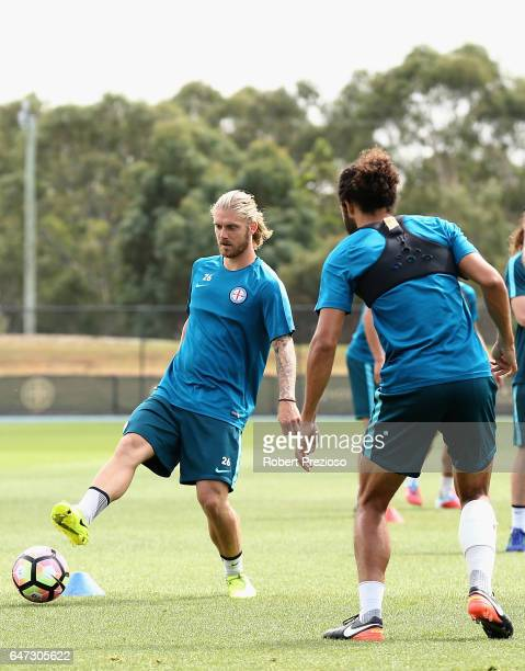Luke Brattan passes the ball during a Melbourne City FC training session at City Football Academy on March 3 2017 in Melbourne Australia