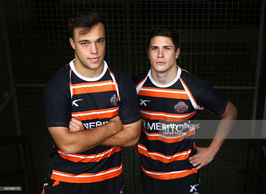 Luke Brooks and Mitchell Moses pose for a photograph during a Wests Tigers NRL training session at Concord Oval on July 15, 2014 in Sydney, Australia.
