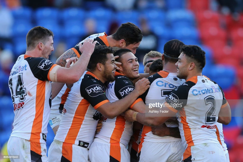 Luke Brooks of the Tigers celebrates his try with his team during the round 17 NRL match between the Newcastle Knights and the Wests TIgers at McDonald Jones Stadium on July 2, 2017 in Newcastle, Australia.