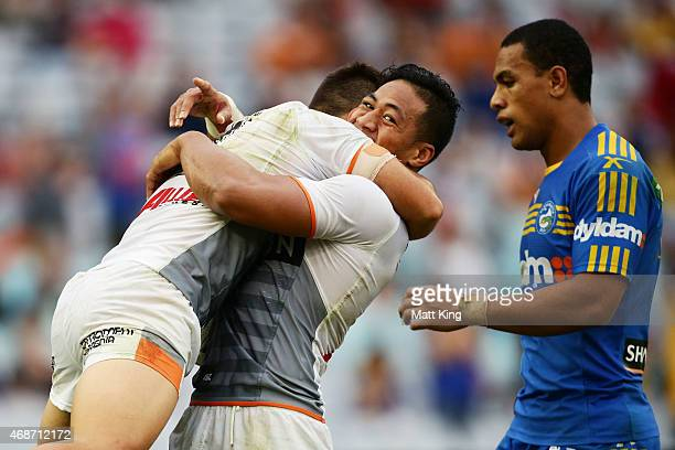 Luke Brooks of the Tigers celebrates with Tim Simona after scoring a try during the round five NRL match between the Parramatta Eels and the Wests...