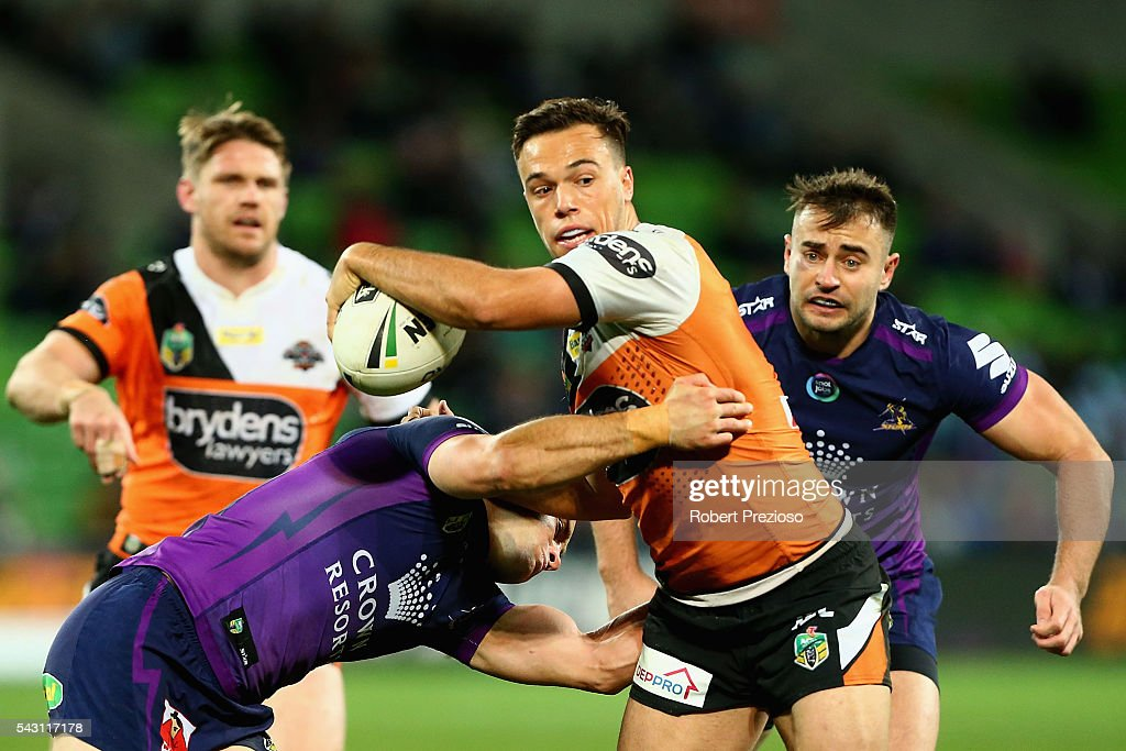 Luke Brooks of the Tigers is tackled during the round 16 NRL match between the Melbourne Storm and Wests Tigers at AAMI Park on June 26, 2016 in Melbourne, Australia.