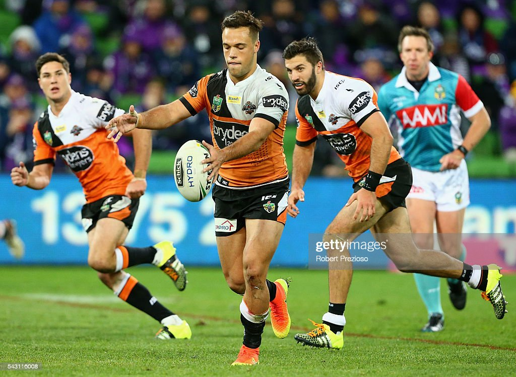 Luke Brooks of the Tigers kicks during the round 16 NRL match between the Melbourne Storm and Wests Tigers at AAMI Park on June 26, 2016 in Melbourne, Australia.