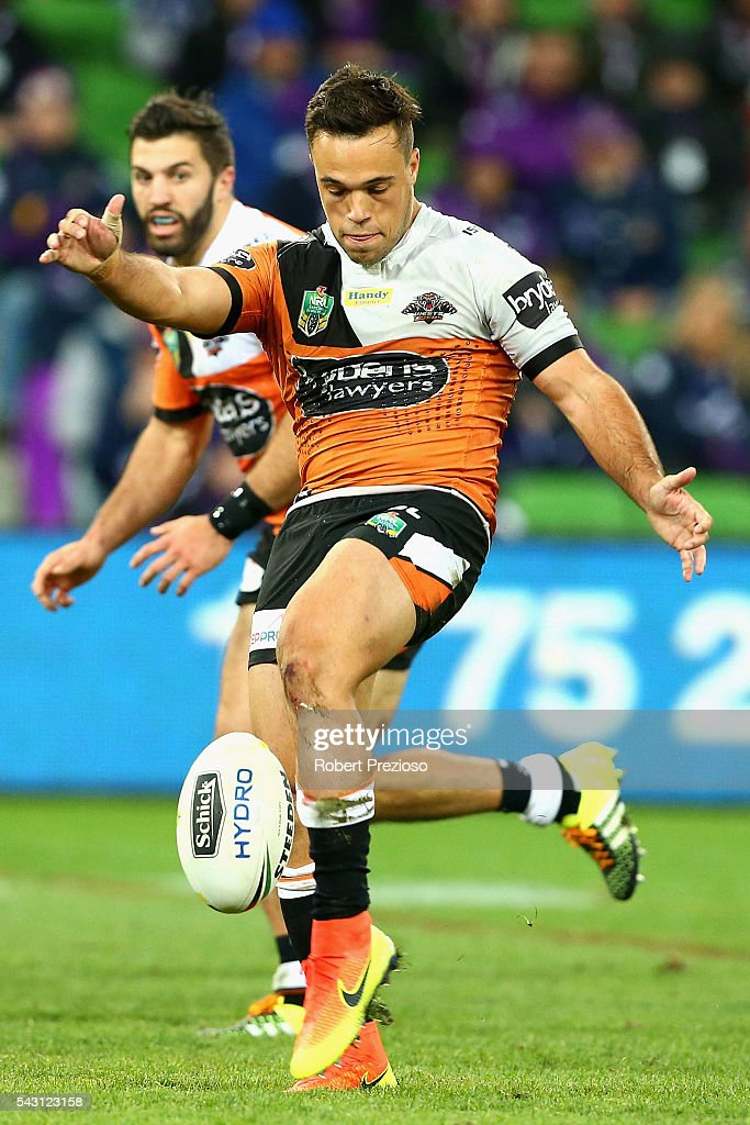 <a gi-track='captionPersonalityLinkClicked' href=/galleries/search?phrase=Luke+Brooks+-+Rugby+League+Player&family=editorial&specificpeople=15667332 ng-click='$event.stopPropagation()'>Luke Brooks</a> of the Tigers kicks during the round 16 NRL match between the Melbourne Storm and Wests Tigers at AAMI Park on June 26, 2016 in Melbourne, Australia.