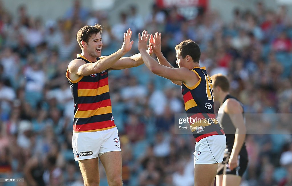 Luke Brown of the Crows is congratulated by his team mates after kicking a goal during the round one AFL NAB Cup match between the Adelaide Crows and the Port Adelaide Power at AAMI Stadium on February 17, 2013 in Adelaide, Australia.