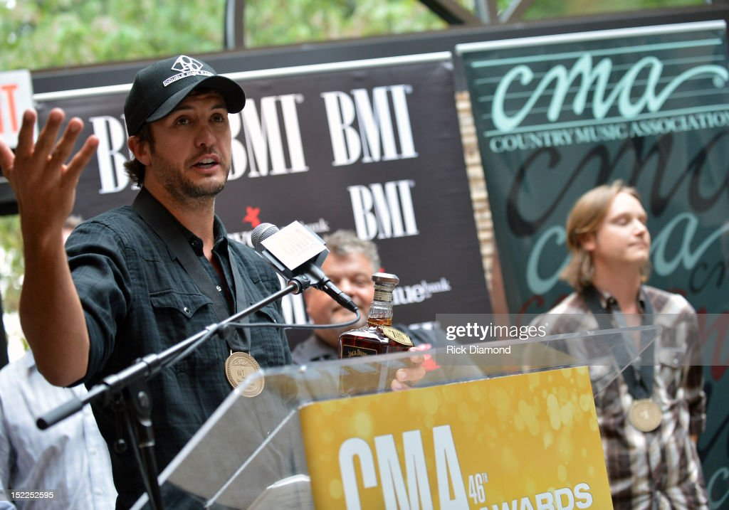 <a gi-track='captionPersonalityLinkClicked' href=/galleries/search?phrase=Luke+Bryan&family=editorial&specificpeople=4001956 ng-click='$event.stopPropagation()'>Luke Bryan</a> (BMI) addresses the crowd during the BMI, ASCAP & CMA # 1 Party For 'Drunk On You' Performed By <a gi-track='captionPersonalityLinkClicked' href=/galleries/search?phrase=Luke+Bryan&family=editorial&specificpeople=4001956 ng-click='$event.stopPropagation()'>Luke Bryan</a> (BMI) Co-Writers Rodney Clawson (BMI) Josh Kerr (ASCAP) and Chris Thompkins (ASCAP) at CMA Office on September 17, 2012 in Nashville, Tennessee.