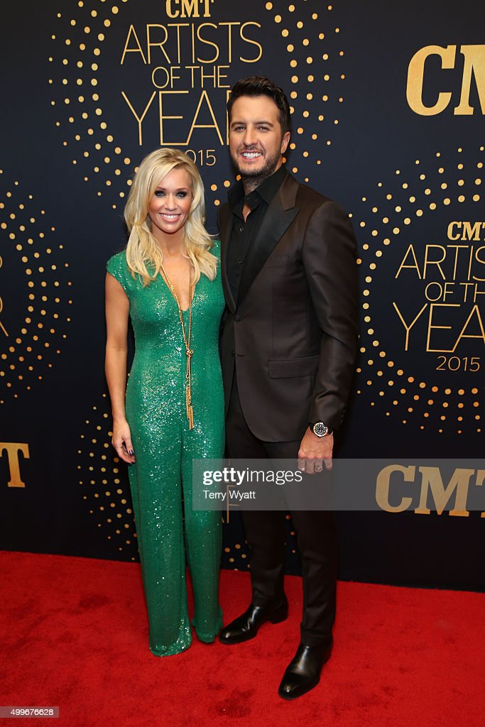 Luke Bryan (R) and Caroline Boyer attend the 2015 'CMT Artists of the Year' at Schermerhorn Symphony Center on December 2, 2015 in Nashville, Tennessee.